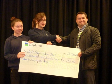 School pupils present Andrew Tee with the cheque