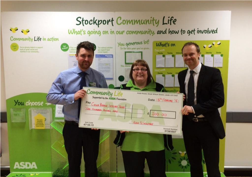 Chris Hart and Mandy Ogden present the cheque to Gordon Cartwright.